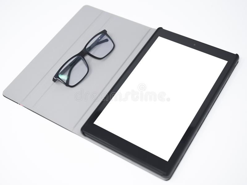 Blank screen tablet and glasses isolated royalty free stock images