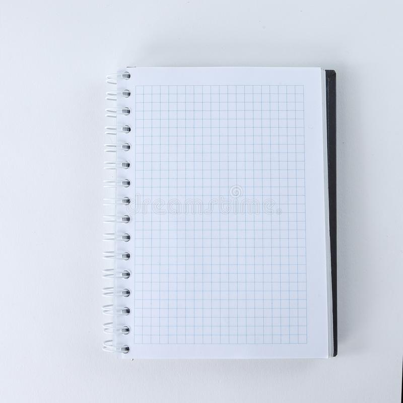 Blank sheet of notebook isolated on a white background.photo wit. H copy space stock photo