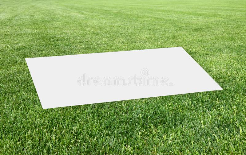 Blank sheet over a beautiful green mowed lawn - Concept image with copy space stock photos