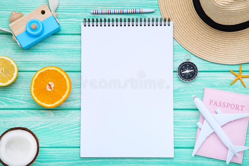 Sheet of paper with fruits and airplane model stock image
