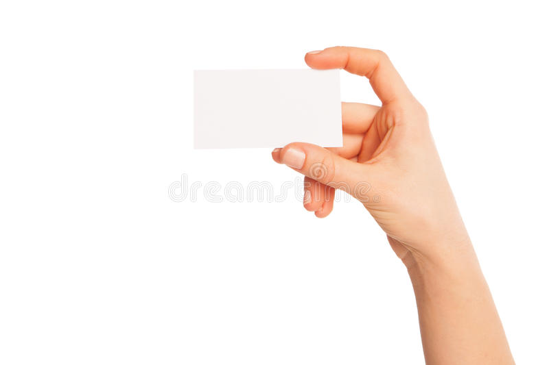 Blank sheet of white paper in hand between fingers. A blank sheet of white paper in hand between fingers. Hand to the left. Isolated, over white background royalty free stock photography