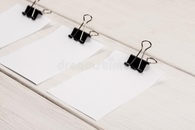 Blank sheets of white paper with paper clip on a white background stock photos