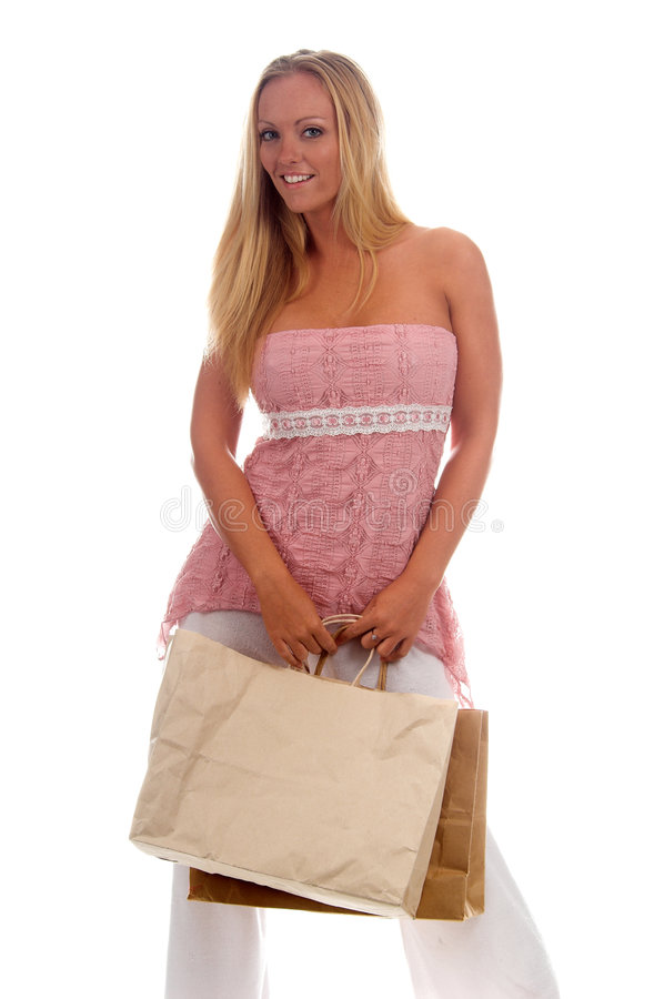 Blank Shopping Bag. Beautiful blond woman in casual fashion carrying blank shopping bags ready for your logo or trademark