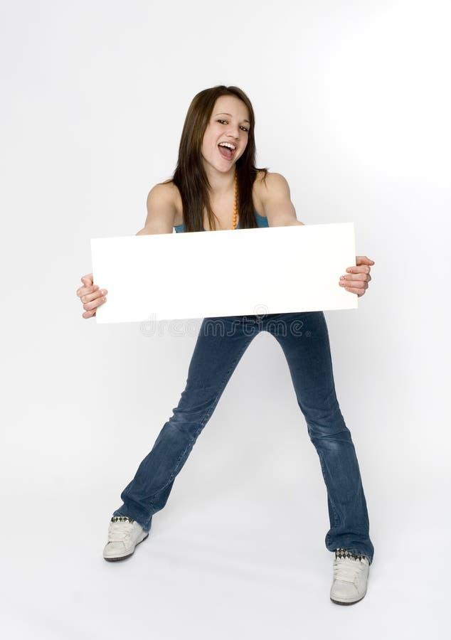 Blank sign. Teen girl holding blank sign. full length stock images