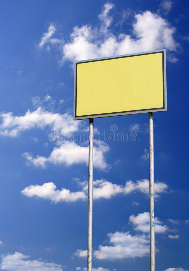 Blank sign against blue sky stock photos