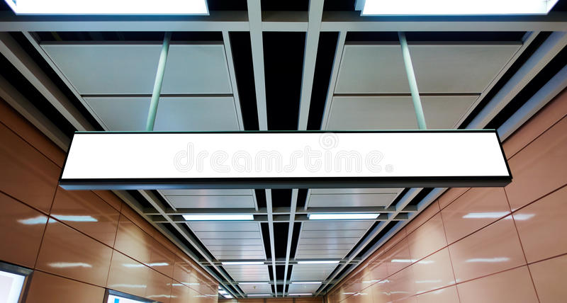 Blank sign board. Hanging on ceiling of subway underground passage stock photo