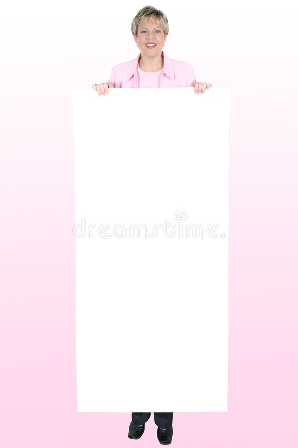 Blank Sign ForText Held By Smiling Woman Over Pink royalty free stock photos