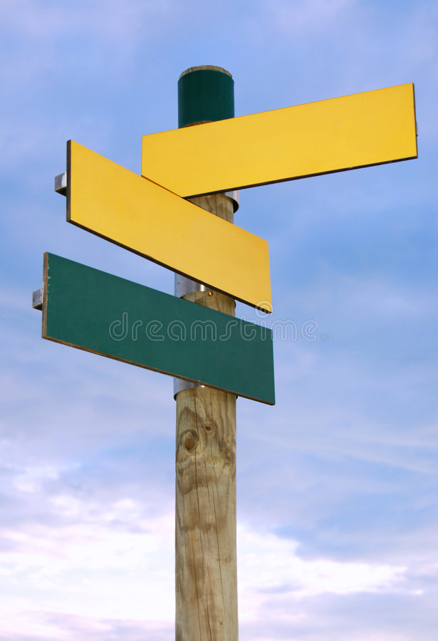 Blank sign post. Image of a blank sign post for directions over an overcast sky royalty free stock photography