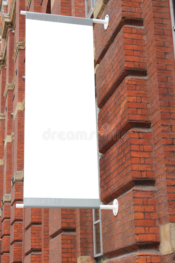 Blank sign or poster. Against red brick wall building royalty free stock photography