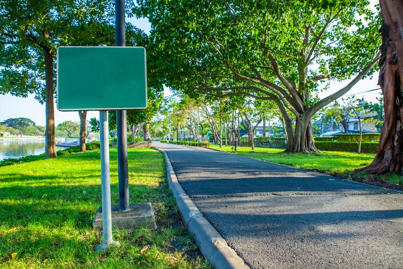 Blank sign on Road pathway Jogging track in the public park und royalty free stock photography