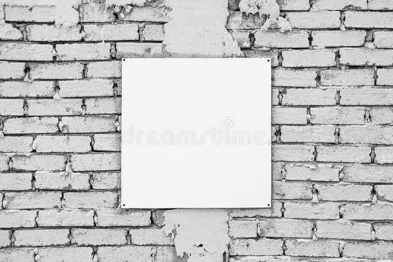 Blank sign on white brick wall. Template mock up royalty free stock photography