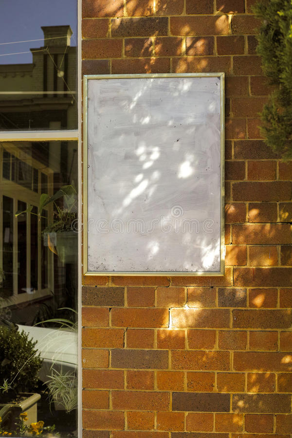 Blank Signboard. A blank Signboard on Brick Wall stock image