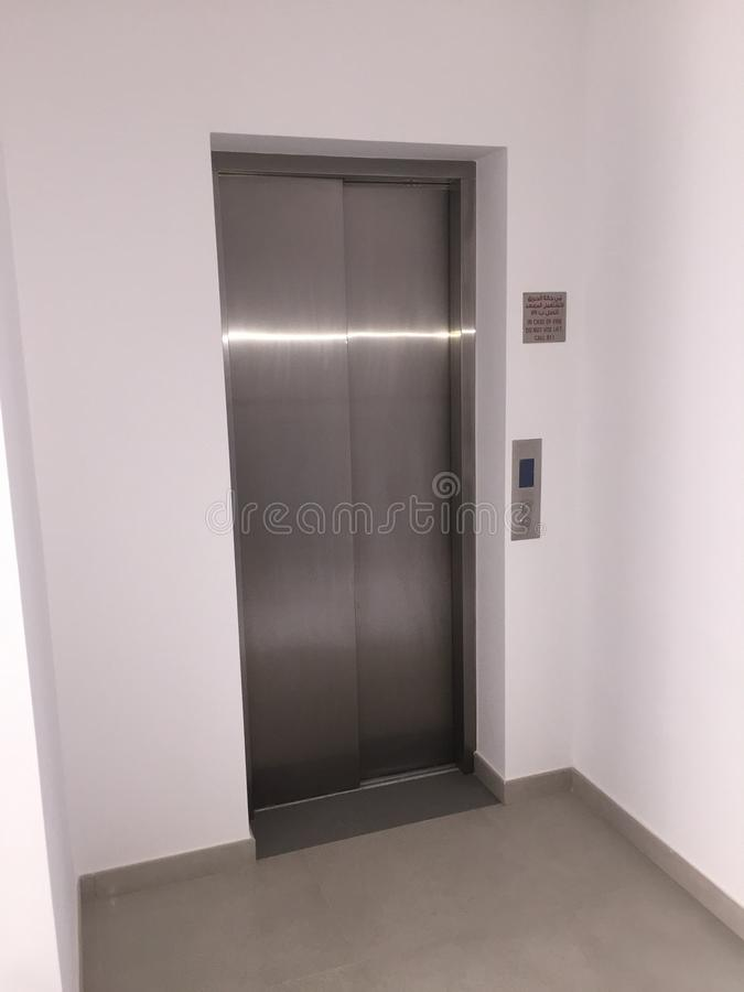 Blank Silver Lift in home Interior. Side View. Empty Lift with buttons close to it. Elevator Interior royalty free stock photography