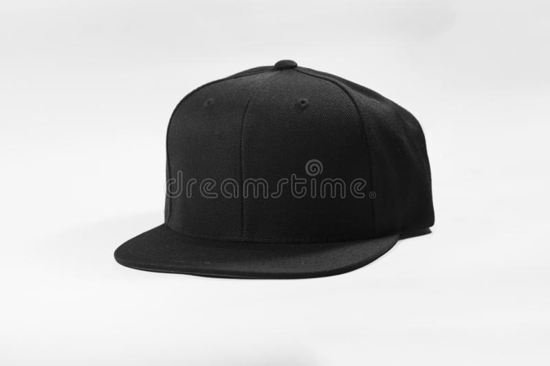 Blank snapback hat cap flat visor on white background isolated. Blank snapback hat cap flat visor with black color on white background isolated, ready for your royalty free stock photography