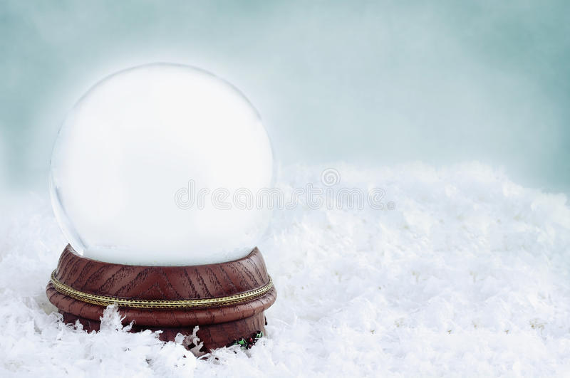 Blank Snow Globe. With with copy space available against a blue background royalty free stock images