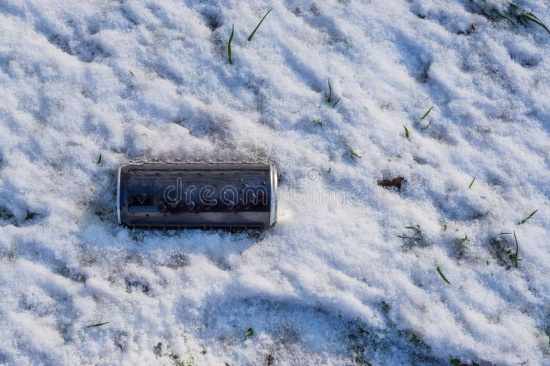 Blank Soda can laying in the snow, awareness for the environment concept royalty free stock image