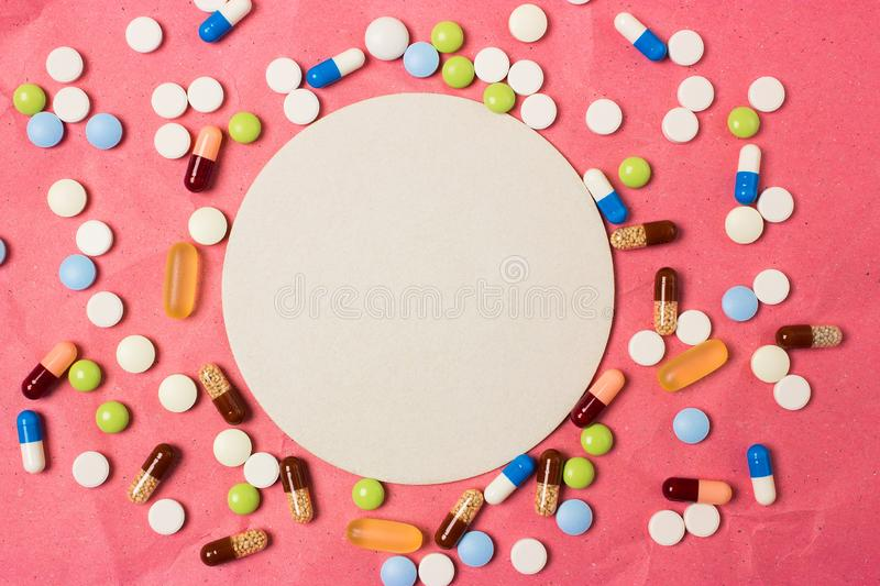 Blank space frame for text with color pills, pills and capsules royalty free stock photos