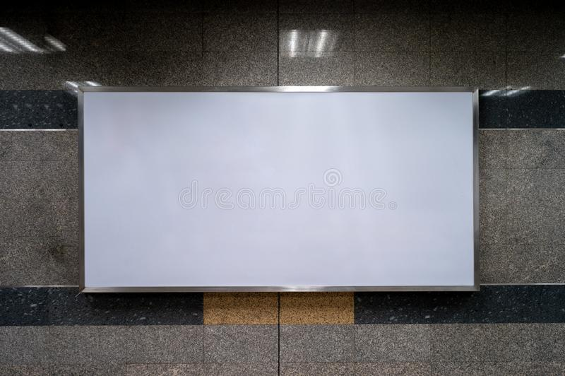 Blank space of light boxes for advertising on the granite wall inside the building and train station royalty free stock images
