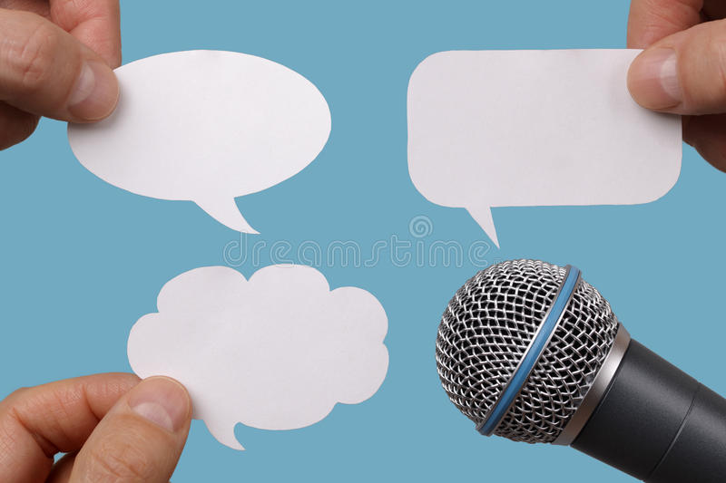 Blank speech bubbles with microphone stock photography