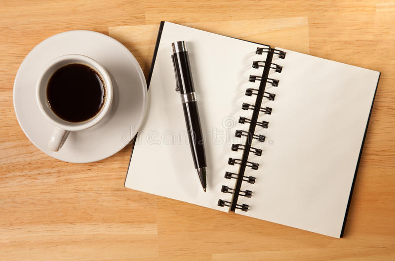Download Blank Spiral Note Pad, Cup And Pen On Wood Royalty Free Stock Images - Image: 12849269