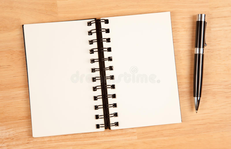 Download Blank Spiral Note Pad And Pen On Wood Stock Photo - Image: 12849260