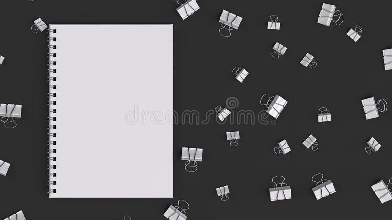 Blank spiral notebook with white binder clips on black table. Business, education or office mockup. 3D rendering illustration royalty free illustration
