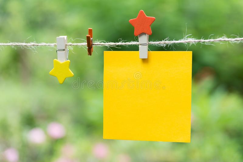 Blank squared notepad pages and the paper clip. Note paper stuck. With paper clip royalty free stock photo