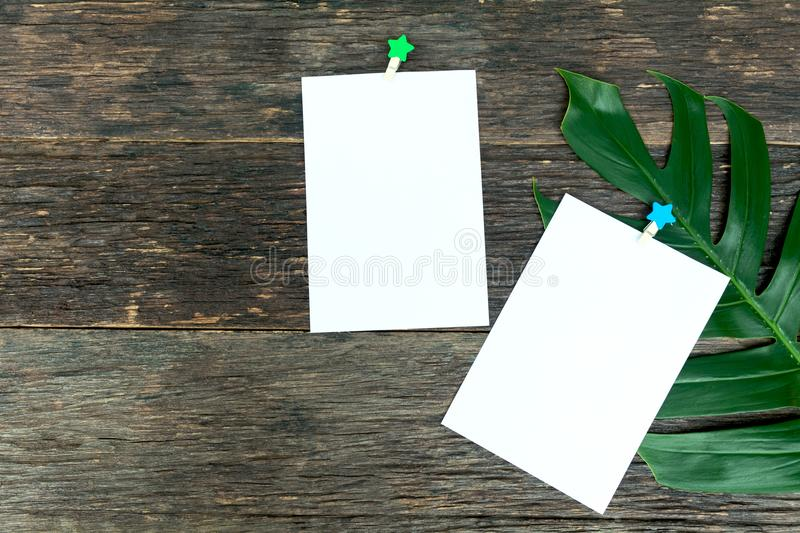 Blank squared notepad pages and the paper clip. Note paper stuck. With paper clip stock image