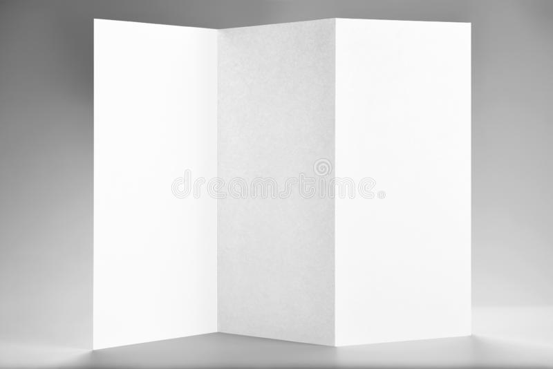 Blank Standing Open Flyer or Letterhead. Over Grey Background stock photos