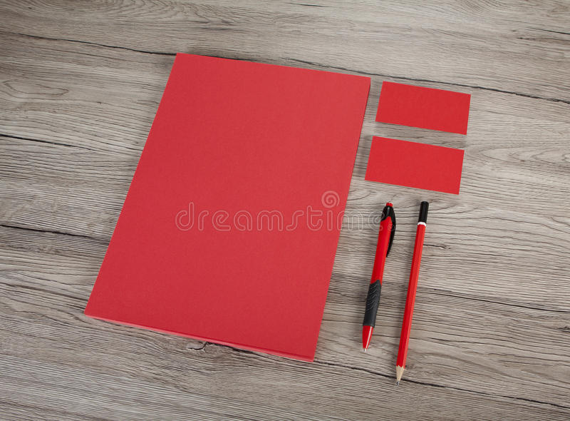 Blank Stationery on wooden background. Consist of Business cards. A4 letterheads, pen and pencil stock images