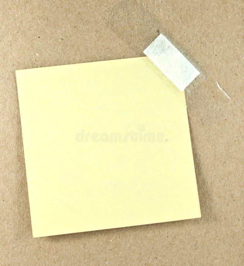 Blank sticky note. On board stock photo