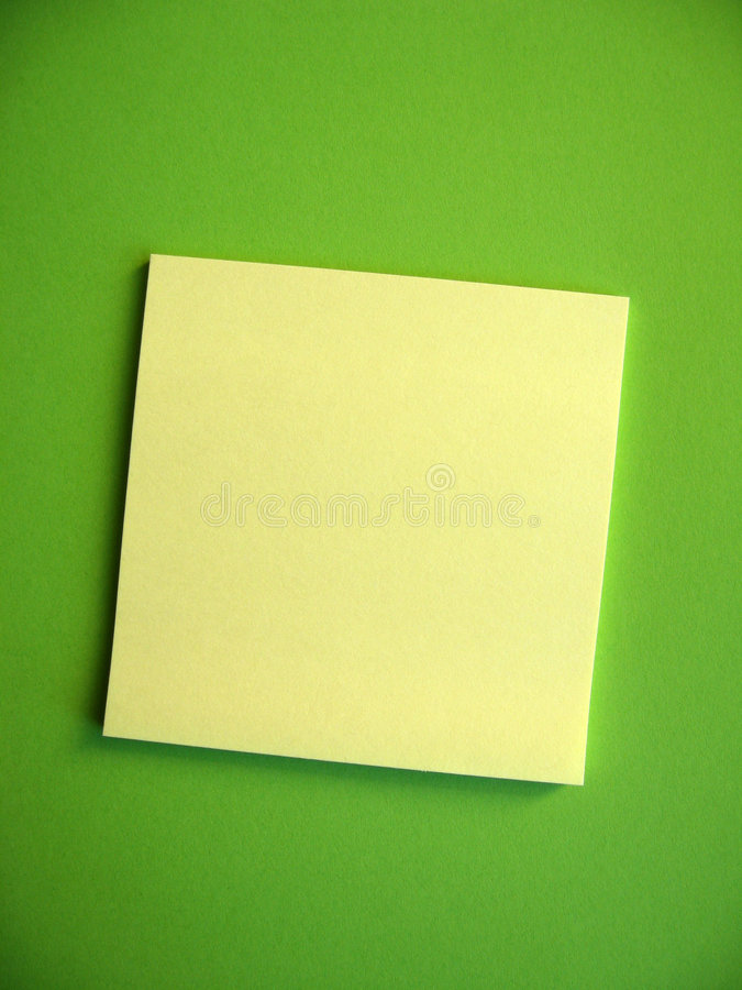Blank Sticky Note. A blank yellow note on green background. Add your own message royalty free stock photography