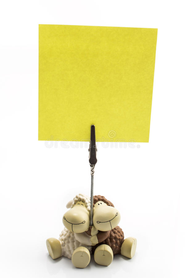 Blank sticky note with clip and figurines sheep stock photos