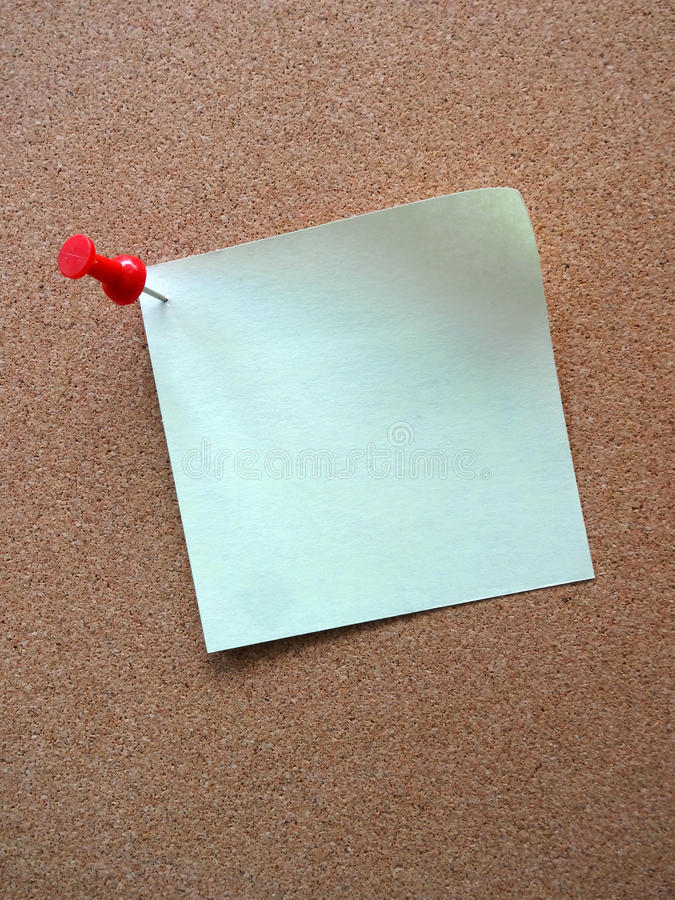 Blank Sticky Note with Pushpin on Cork Board. Single Blank Sticky Note with Pushpin on a Cork Memo Board royalty free stock photo