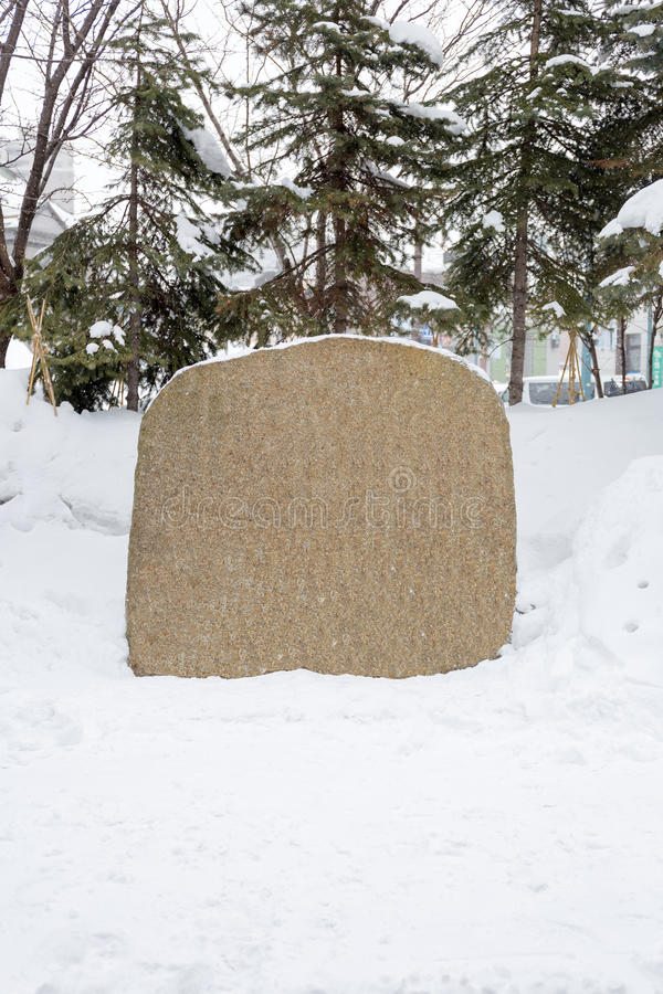 Blank stone in snow royalty free stock photography