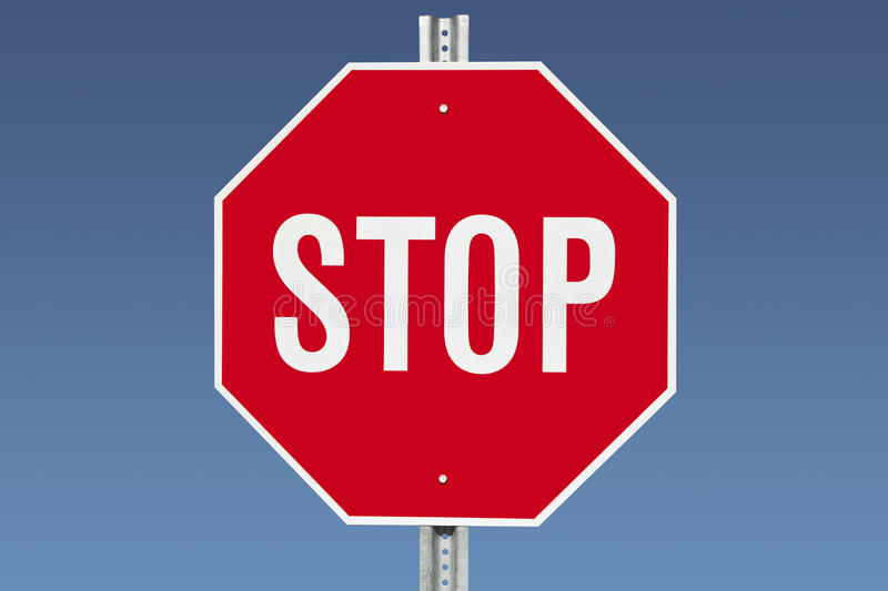 Stop Sign. On a gradient blue sky royalty free stock photos