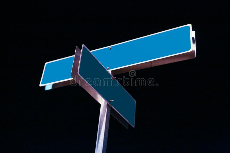 Blank street signs. On night sky stock image