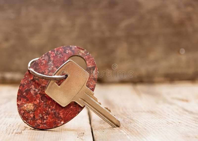 Blank tag and a key. On wooden background royalty free stock photos