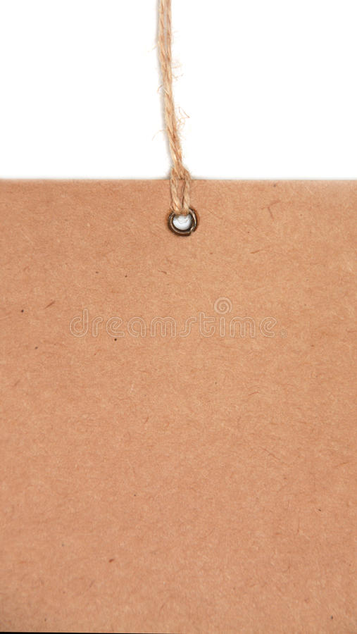 Blank tag tied with brown string. stock image