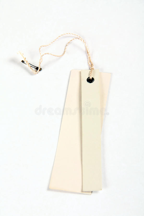 Blank tag tied with brown string. stock photo