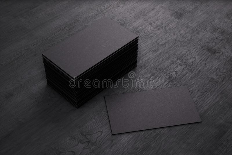Blank template black Business Cards on black wooden background. 3D rendering royalty free illustration