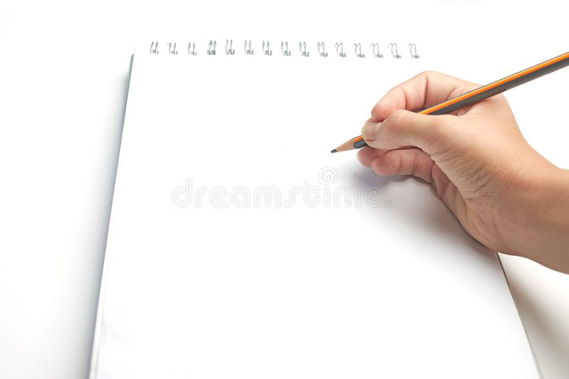 Blank for drawing or sketching. Hand with pencil on a white album sheet stock photography
