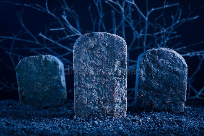 Blank tombstone. In the dark night at graveyard, halloween background stock photo