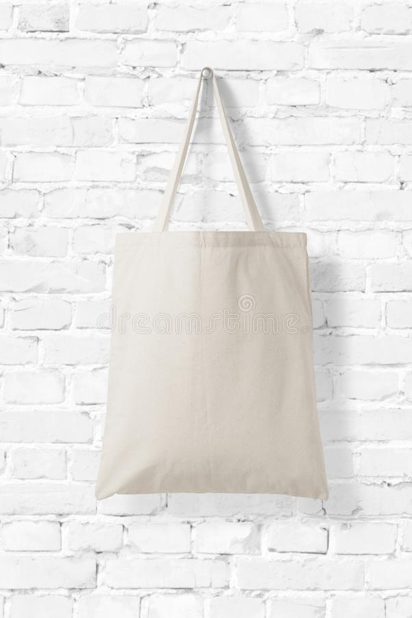 Blank Tote Canvas Bag Mockup on white brick wall background. stock images