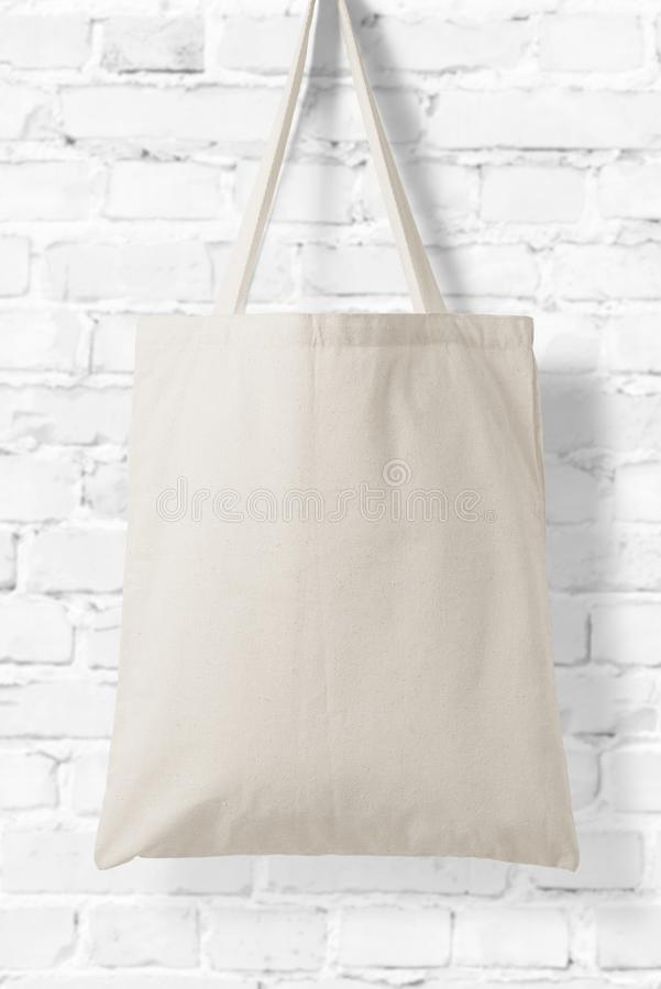 Blank Tote Canvas Bag Mockup on white brick wall background. stock image