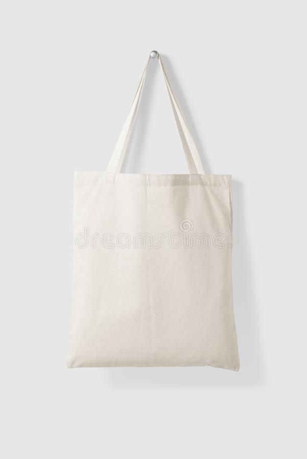 Blank Tote Canvas Bag Mockup on light grey background. High resolution royalty free stock photo
