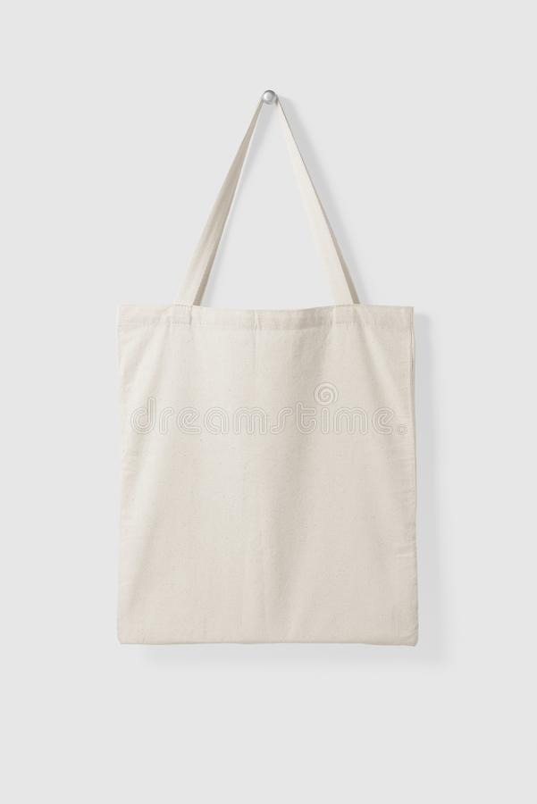 Blank Tote Canvas Bag Mockup on light grey background. High resolution stock photography