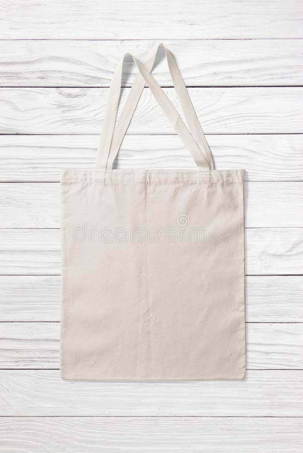 Blank Tote Canvas Bag Mockup on white wooden background. royalty free stock image