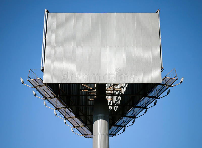 Blank triangle gray billboard. On blue sky stock photography