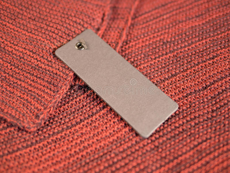 Blank two label price tags mockup on wool. stock photography